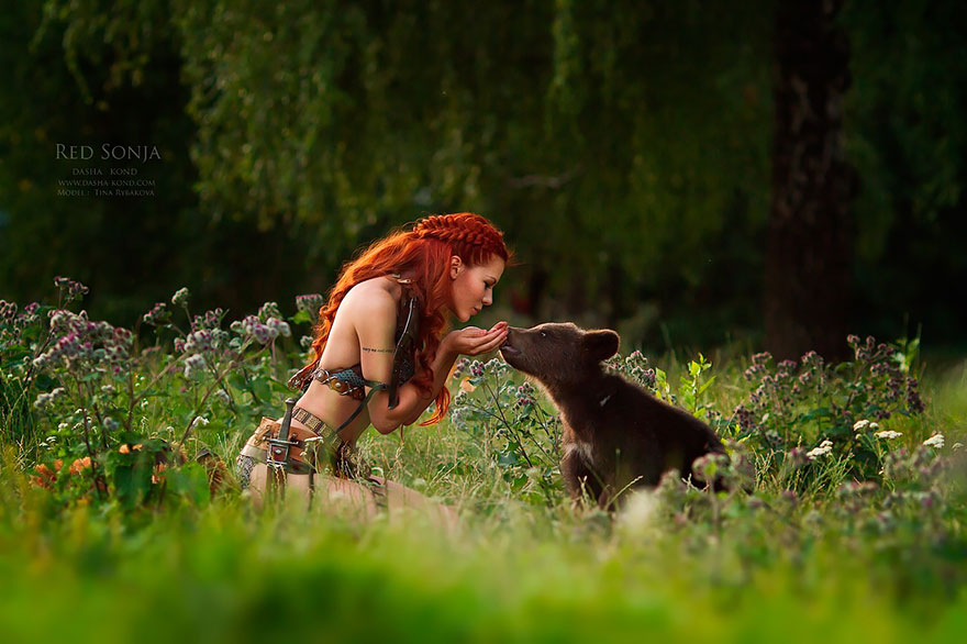This Photographer Takes Pictures of Model in Fairytale Costumes With Wild Animals